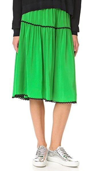 Get this Kenzo's knee skirt now! Click for more details. Worldwide shipping. KENZO Silk Midi Skirt: Rickrack trim adds playful charm to this silk KENZO skirt. Ruched tiers create a soft, swingy drape. Exposed back zip. Lined. Fabric: Silk crepe. 100% silk. Dry clean. Imported, China. Measurements Length: 27.5in / 70cm, from shoulder Measurements from size 36 (falda por la rodilla, rodilla, rodillas, medio largo, media pierna, knee-length, knee length, 3 / 4 length, midi skirt, mid-rise…
