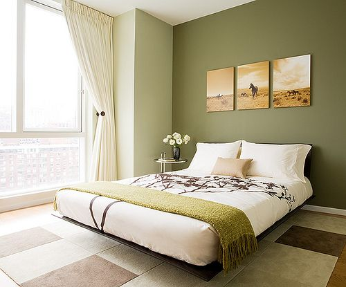olive green brown and cream colors and minimal decor gives this bedroom a zen feel - Green Bedroom Design