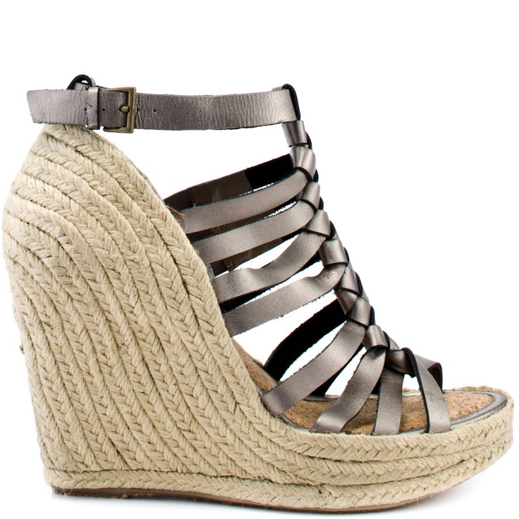 Your must have vacation sandal is here from Enzo Angiolini.  Ramie has a pewter leather upper with knot and strap detail at the vamp.  An adjustable ankle strap and espadrille detail cover the 4 inch hidden wedge.