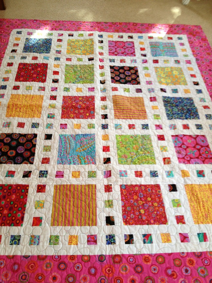 Stunning Modern Handmade Quilt featuring Kaffe Fassett's vibrant bold colorful fabrics set against a vivid white background. $600.00, via Etsy.
