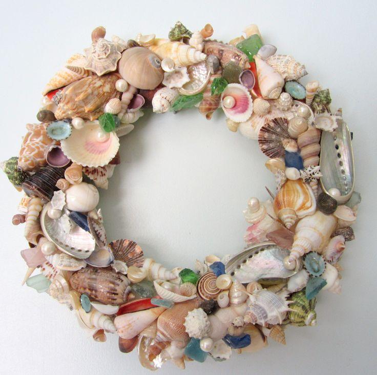 Seashell Wreath for Beach Decor - Nautical Decor Shell Wreath w Sea Glass. $100.00, via Etsy.