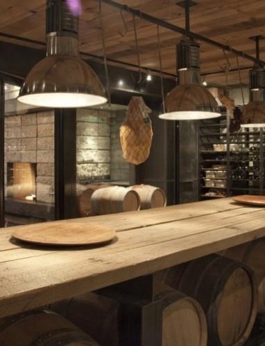 wine cellar, rustic table, industrial light