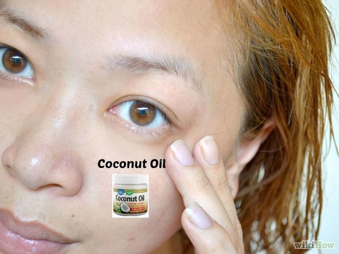 Rub a little coconut oil around your eyes. Coconut oil is a wonderful undereye and eyelid cream. It helps moisturize that paper-thin skin, improving dark circles and keeping wrinkles at bay. Rub a tiny amount around your eyes, focusing on areas that have wrinkles. You probably only need a pea-sized amount for each eye. Take care not to use too much. Avoid getting the coconut oil in your eyes. It will thinly coat your eyes, making your vision blurry for a little while!