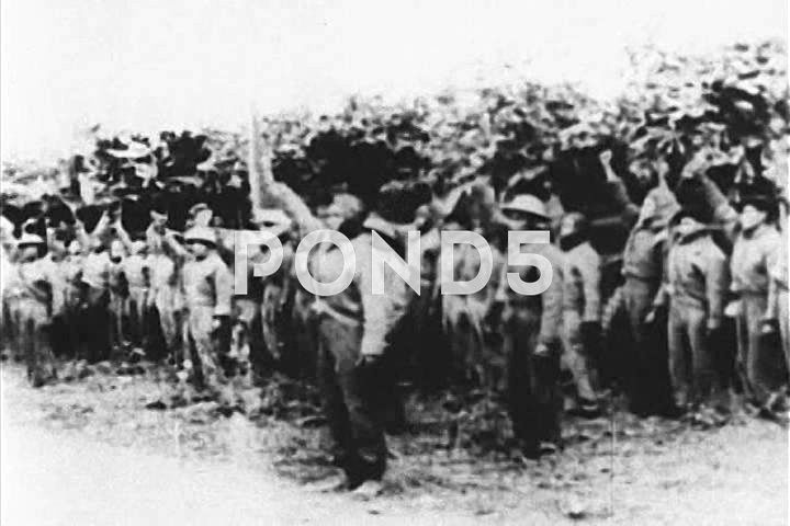 People's Army of Vietnam troops and villagers work and