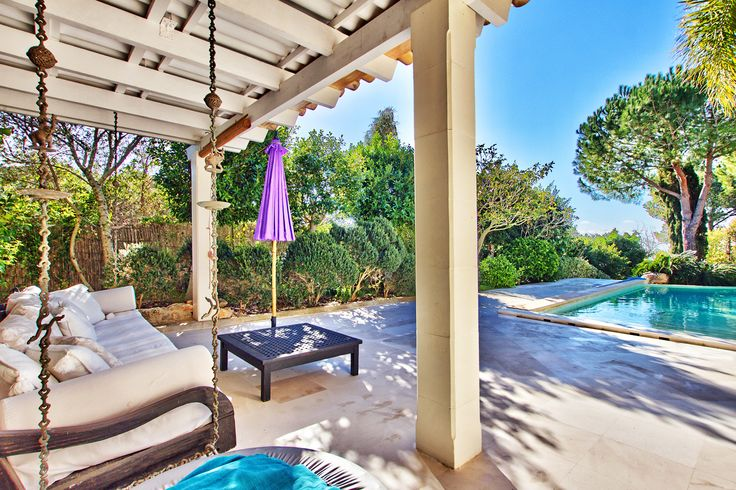 Romantic porch swing by the pool patio design mallorca for Kapfer pool design mallorca