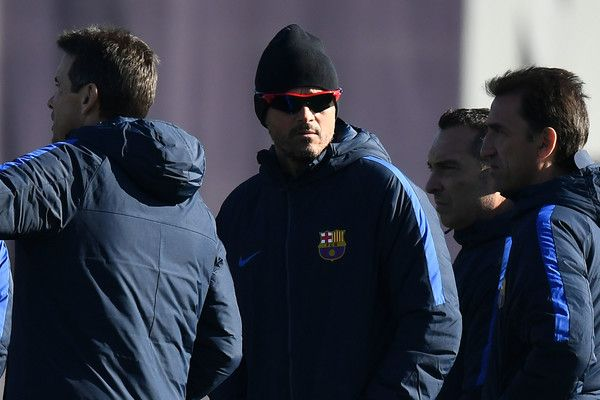 Head coach Luis Enrique (C) of FC Barcelona looks on during a training session ahead of their La Liga match between FC Barcelona and Real Madrid on December 2, 2016 in Barcelona, Catalonia.