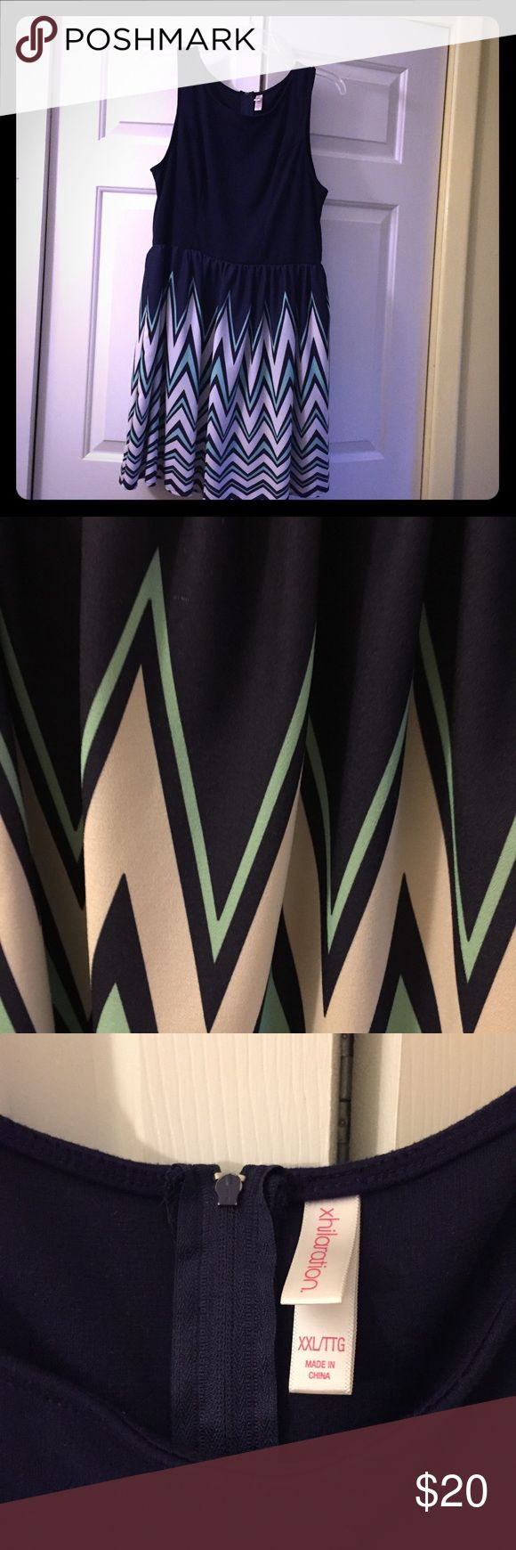 EUC navy chevron dress Super cut for work or the weekend, this chevron dress is in excellent condition. Top is cotton like and bottom is more polyester, printed pattern. Minor mistake as shown in pic but not noticeable unless you're looking for it. Make me an offer or add to a bundle! Xhilaration Dresses Midi
