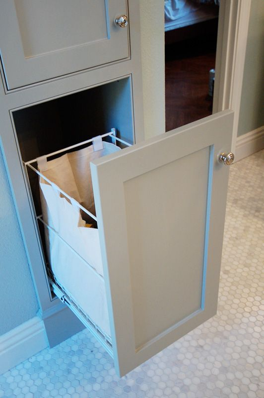 Need a pull-out laundry hamper like this in my next bathroom renovation! #bathroom #hamper #shakerstyle #gray