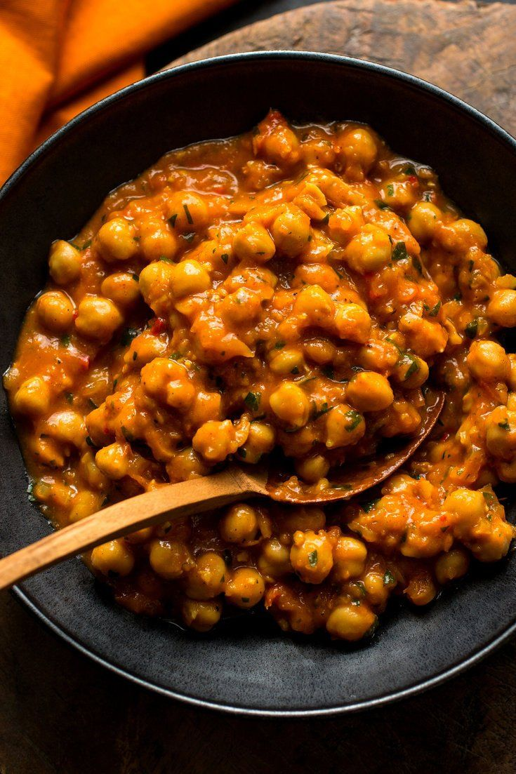 NYT Cooking: An Indian chickpea stew, chana Punjabi is a plain-Jane of a dish: beige beans in a tomato-based spiced sauce, flecked with minced cilantro. Mixed with rice, though, it becomes a soulful meal whose charms are hard to resist.<br/><br/>This version belongs to Heather Carlucci-Rodriguez, the chef and owner of Lassi, a 420-square-foot sliver of an Indian cafe with a counter and a...