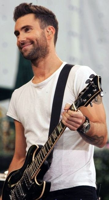 Adam Levine - it might be the tattoos, it could be the perfect scruffy beard, but it's probably the guitar more than anything.  Damn!