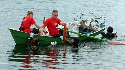 Coca-Cola HBC employees on a boat cleaning up a river in the baltics    #cchbc  #cocacola  #csr  #recycling  #environment