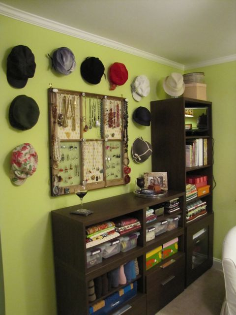 Great hat storage idea: Hang hats on round plastic containers attached to the wall with Command strips