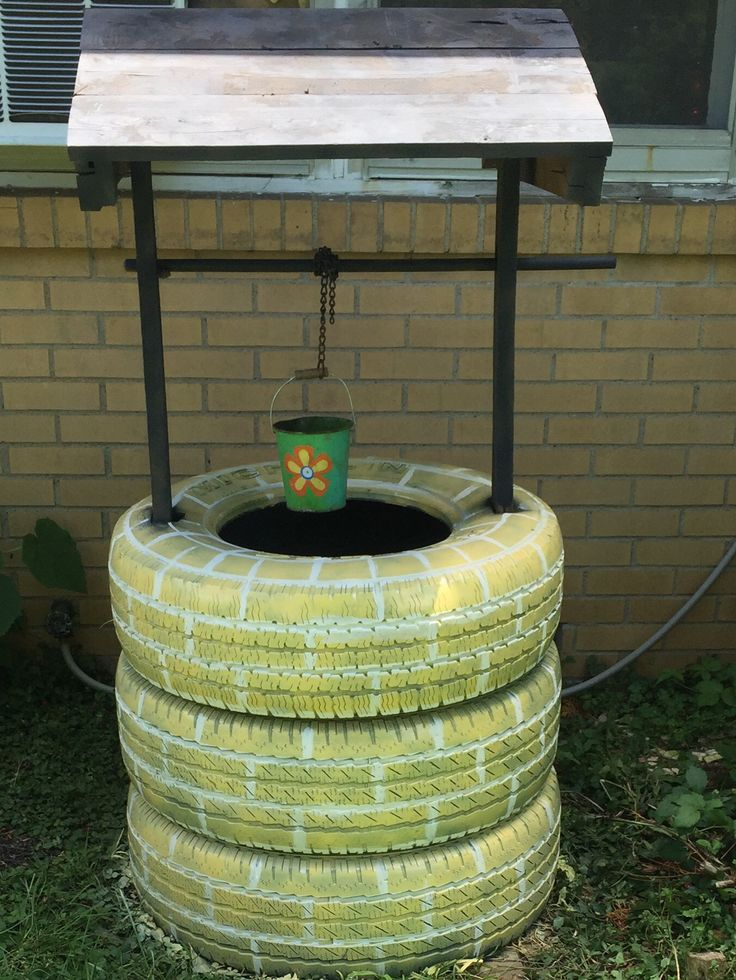 My old tire wishing well ️ | Crafts | Tire craft, Tire art ...