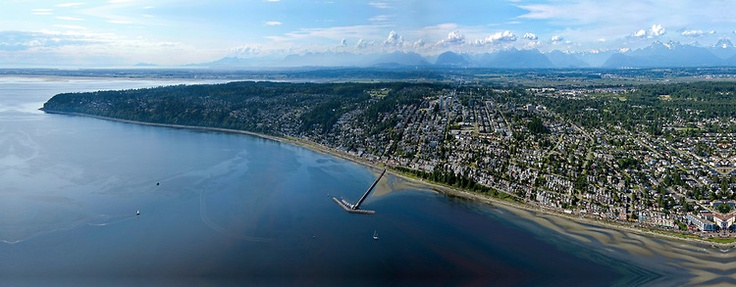 Gorgeous #WhiteRock Aerial Photo - OCEAN VIEWS from an amazing aerial panorama of the entire West Beach and East Beach and Ocean Park with The Pier and the tidal pools. Vancouver city in the background. North Shore mountains to the far North