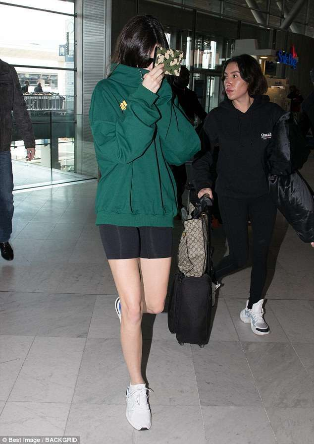 sneakers for cheap e3437 d2570 Comfy Kendall Jenner was a model on the move as she arrived at the airport  in Paris, France for a flight to Los Angeles on Thursday