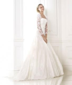 Basico:  A full tulle gown with lace appliqués, a strapless bodice, long lace sleeves and slim bow belt.  Fabric- Tulle, with rebrode and guipure lace appliqués.  Colours- Off white Optical white