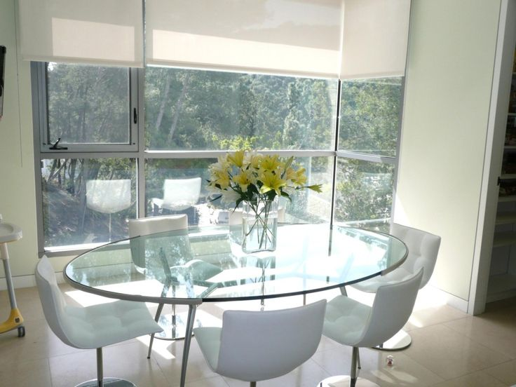 Ideas: Modern Breakfast Nook With Bay Window Idea And Oval Glass Table Design Also Stylish White Swivel Chairs: Elegant Breakfast Nook Decoration