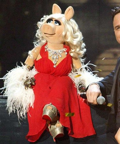 Miss Piggy, the lady pig in the red dress ;)