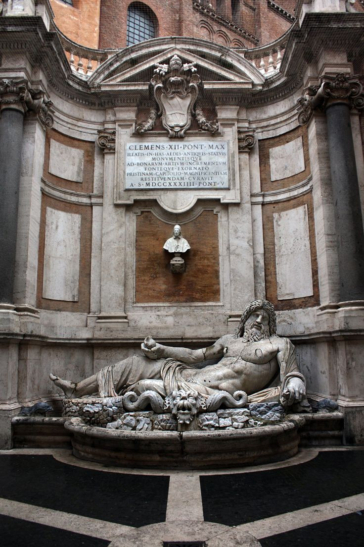 Marforio. Pope Sixtus V Peretti had the statue moved to the Piazza di San Marco (Rome) in 1588, and then up to the Piazza del Campidoglio in 1592, where it decorates a fountain designed by Giacomo della Porta on a wall of the Basilica di Santa Maria in Ara Coeli, facing the Palazzo dei Conservatori. In 1645, the building of the Palazzo Nuovo enclosed the fountain into a courtyard.