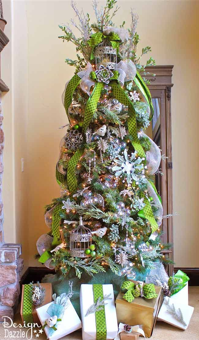 Silvery sage, apple green, floral, glitter, moss, birds,  and more! This is what a Jeweled Forest Christmas Tree looks like. Designed by Toni of Design Dazzle. #christmastrees #dreamtree #christmastreedecorating