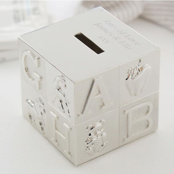 Looking for an impressive silver-finish baby gift to mark a special occasion? Look no further than our beautifully-designed ABC money box silver plated baby gift, which can be engraved with a special message for a personal touch. The ideal gift for the baby who has everything, our ABC money box silver-finish baby gift will be cherished for years to come.