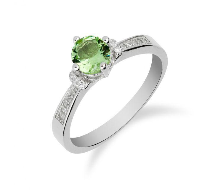 Stříbrný prsten s chrysolitem a řadou zirkonů
