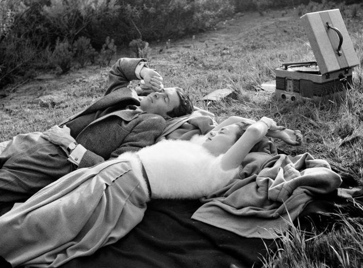 James Stewart and Olivia de Havilland listening to records. 1936.