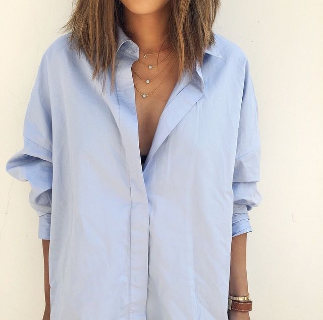 blue shirt and dainty jewelry