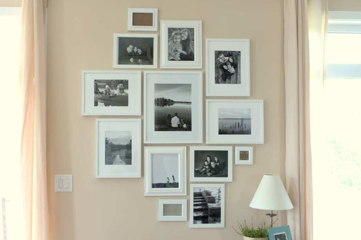 Wall picture frames arrangement on the peach wall