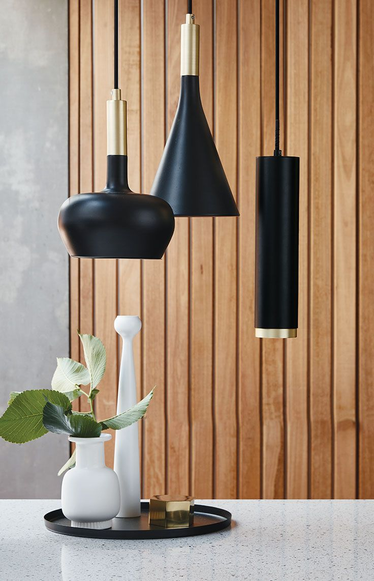 The Beacon Lighting LEDlux Carter dimmable LED pendant in black with brass ring detail.