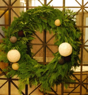...yarn ball wreaths, by the clay pot.