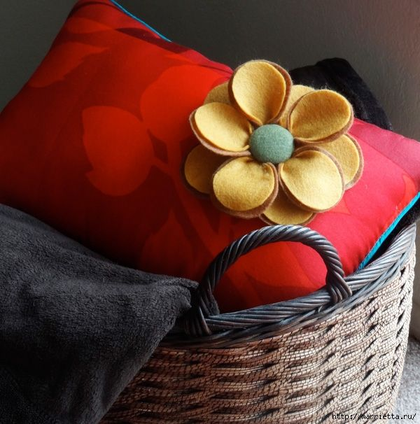 Beautiful cushion with flowers made of felt . Small collection of beautiful pillows with flowers made of felt. And on one pillow attached photo class.