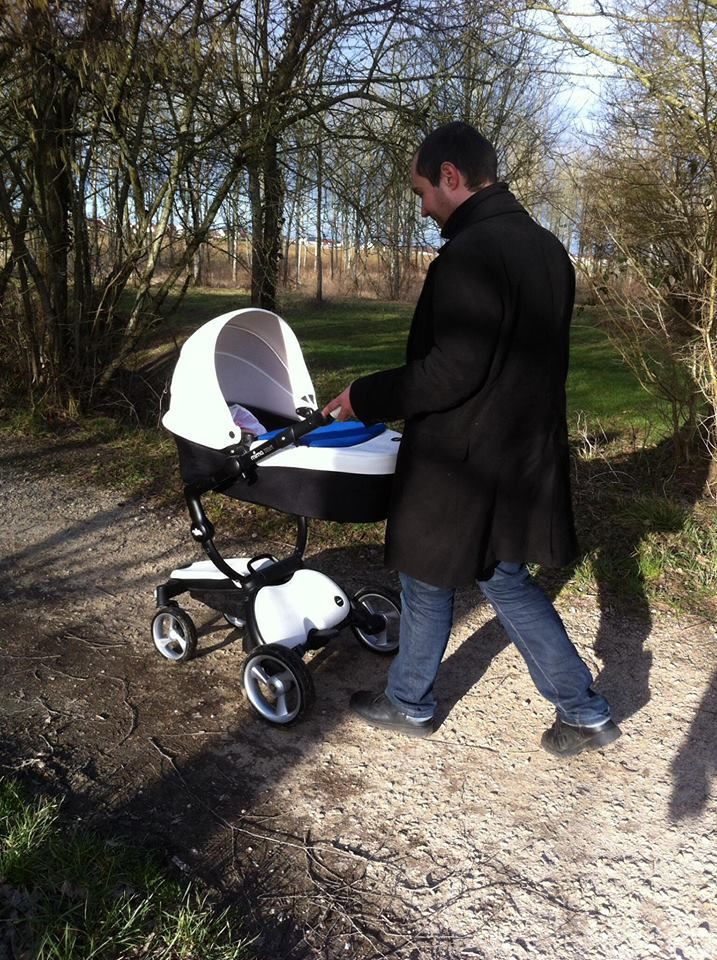 Anne-Cécile's husband enjoying a stroll with their little one in France