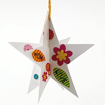 Hanging Stars: Download our star template below. Cut out two star shapes from card stock. Slit one star from the top point to the middle and the second from the bottom to the center point. Adorn each star with leftover buttons, gems, and stickers. Slide the two stars together, punch a hole at the top, and thread ribbon through the hole for hanging.