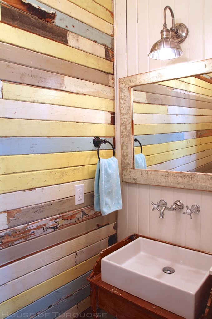 bath with salvaged boards on wall | Cottage on the Green - Tybee Island