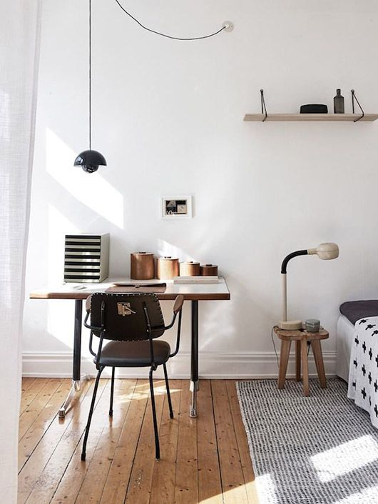 Open, airy apartment. Joint bedroom and desk space. White walls and bright light.