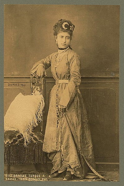 Turkish woman, full-length portrait, standing, facing front, in Damascus. Date 1889