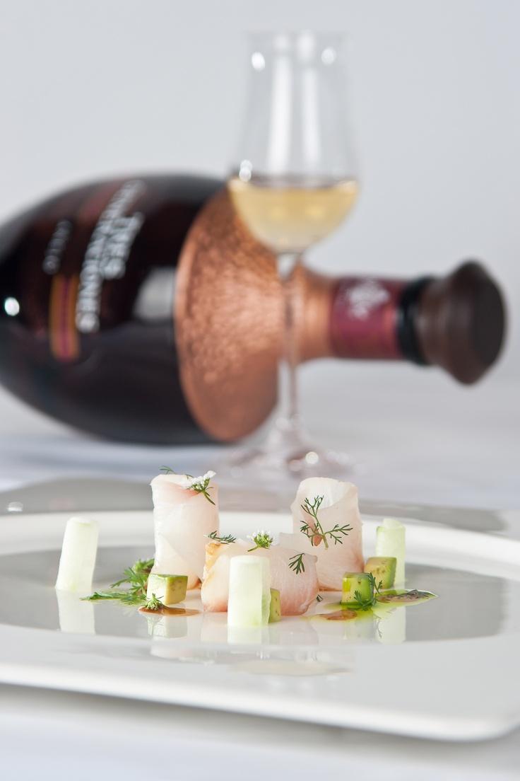 Bacalao Ahumado creado por los Chefs Israel Montero y Alfredo Chávez de Kaah Siis acompañado por un tequila Tres Generaciones Añejo y equilibrado con Acqua Panna.