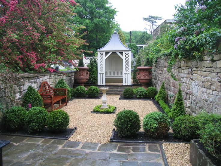 Perfect for a town garden - lower maintenance & lovely year round. Walled or hedged.