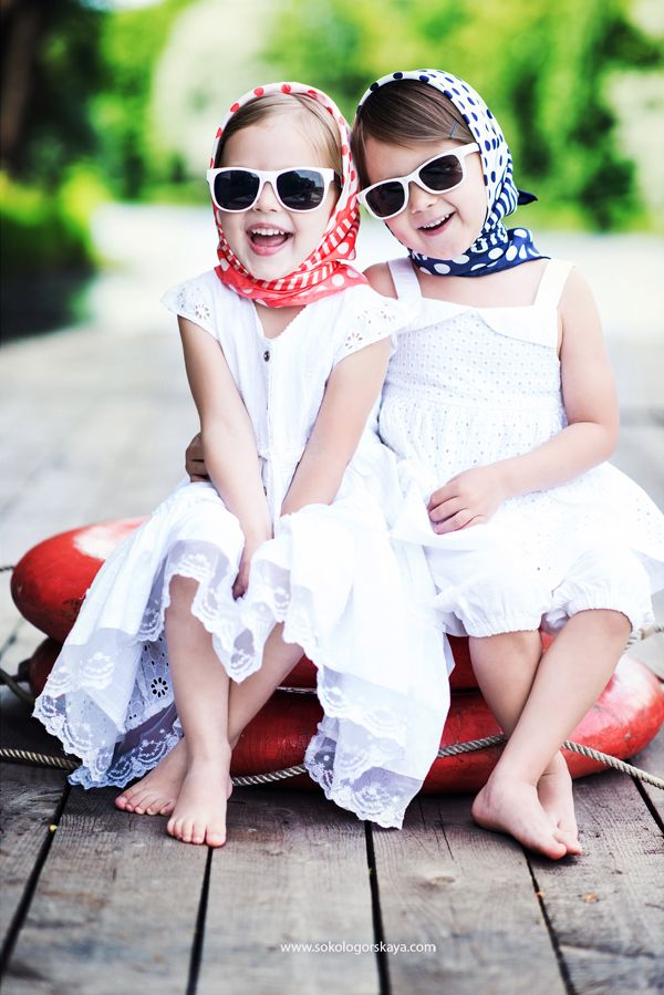 Two very sophisticated little ladies! I'd be this happy if I could pull of the classic headscarf and shades look too... I'd not even look half as fabulous as these two smilers!