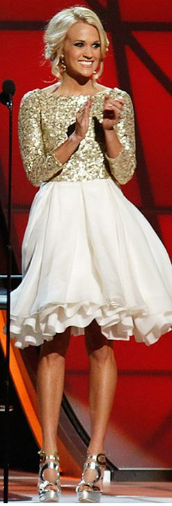 Who made Carrie Underwood's gold sequin top, white skirt, silver sandals, and jewelry that she wore in Nashville on November 1, 2012?