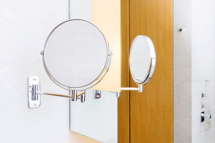 Adjustable wall mounted makeup mirror