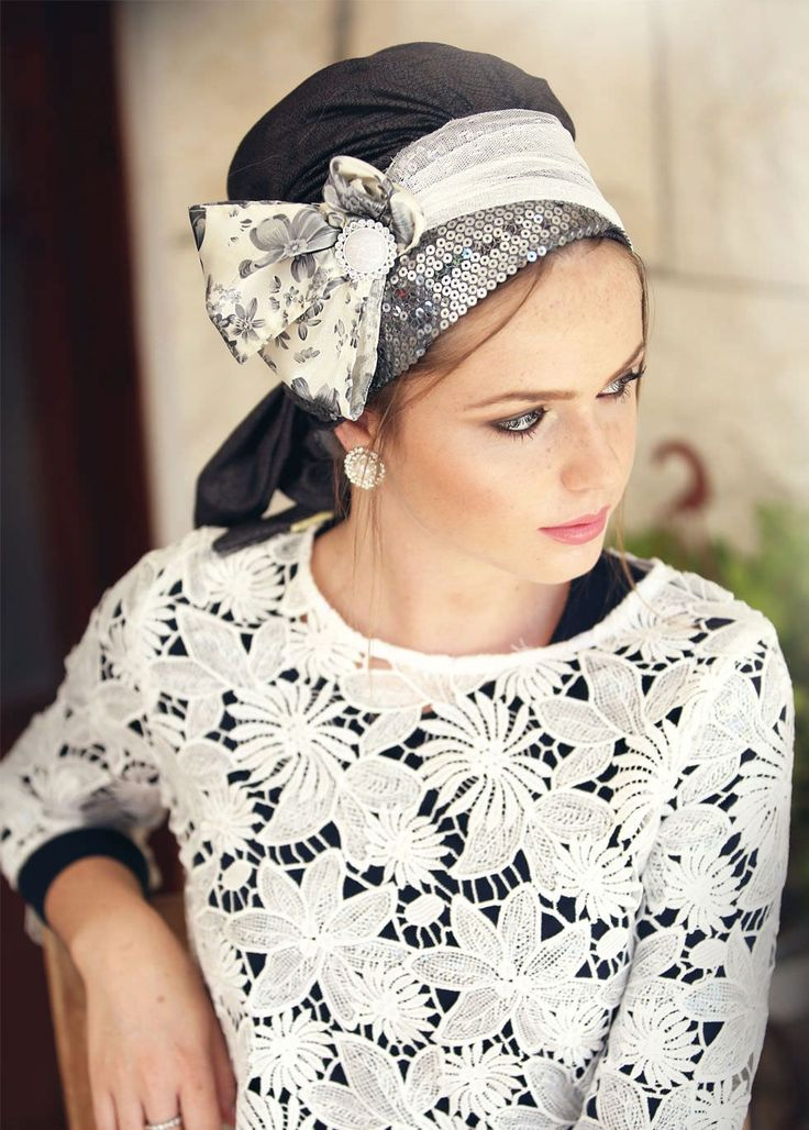 Sinar style head covering made of lycra, in snake patterned denim color. Place this head covering on your head, and wrap the two strands around your head to tie at the base. This basic head covering can be purchased with an added headband, which closes