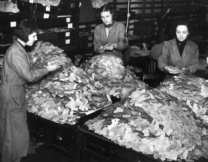 Women sorting through tube tickets to find out the least and most frequently used routes.The information gathered was used to help develop plans to expand the network.