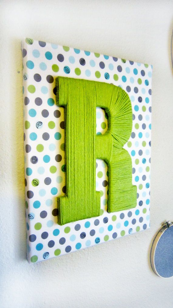 Custom Fabric Wrapped Canvas with Yarn Letter -- Could definitely decorate Travis' room with this