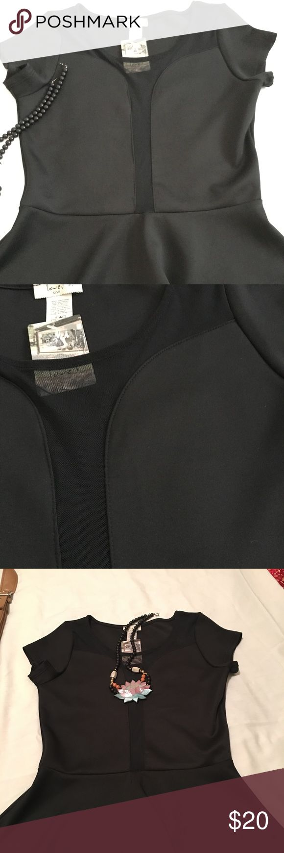 Opt for the little black top! Sheer magic! Pretty peplum, black, pullover, with short sleeves. A sheer front accent, the waist defining peplum, wow! Note fits more like a large *** Love J Tops