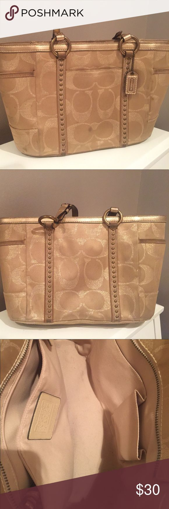 Authentic Gold Shimmer COACH Purse *USED* Authentic Gold Shimmer COACH Purse *USED* -everyday use stains - needs to be cleaned with fabric cleaner - inside of purse LIKE NEW Coach Bags Shoulder Bags