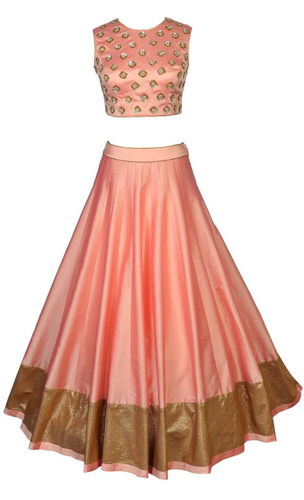 This set featuresa very classy peachblouse in silk base with all over gold sequins and pearl handembellished botis and features a sheer back with matching dori tie up with gold tasseled hangings.It is teamed up with a full flared/ghera peach lehenga in silk base with gold shimmer and peach silk border.It comes with a contrast mintnet dupatta with gold shimmer, peach silk and kundan hand embellished border. Fit into this plush and eye catching ceremonialcreation and look super clas...
