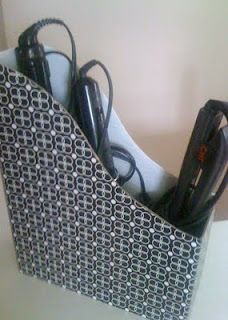 Use a file holder for storing your curling irons, straightners, etc under the bathroom sink or in a linen closet.