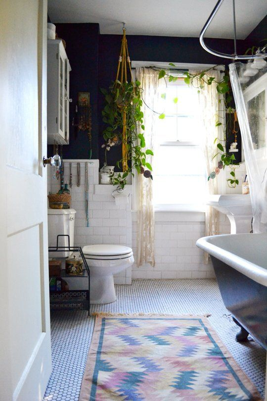 Give your plants a lift and use macrame plant holders around your home. Lauren Naimola & Chad Pratt's plant filled bathroom in Ypsilanti, Michigan.
